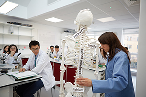 Teacher and students, biology at Abbey College Cambridge