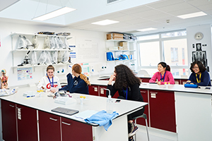 Students in biology lab at abbey college cambridge